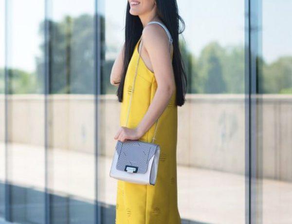 Abito giallo e borsa bianca - Sara Poiese